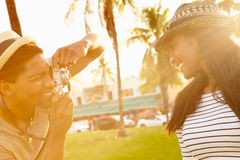 Man Taking Photograph Of Woman In Park Royalty Free Stock Images