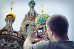 Man taking photos of church Royalty Free Stock Images