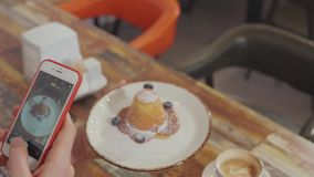 Man is taking photos of food in restaurant by mobile phone, closeup stock video footage
