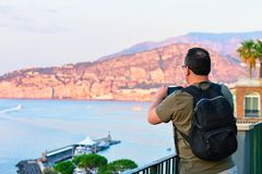 Man taking photos on mobile phone at Marina Grande Sorrento. Man taking photos on mobile phone at Marina Grande in Sorrento, Tyrrhenian sea, Amalfi coast, Italy Stock Photography