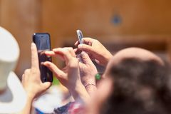 Man taking photos of the procession using mobile phone. royalty free stock image