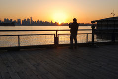 Man taking photos at sunset Royalty Free Stock Photos