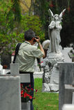 Man taking pic. Ture at grave Stock Photography