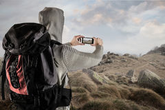 Man taking a pic of the path Stock Photography