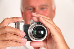 Man taking picture. Mature man taking a photograph with camera Royalty Free Stock Photo