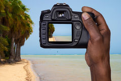 Man taking a picture of a beach Royalty Free Stock Photos