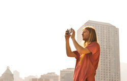 Man taking Picture on a bright Day. In Hing Kong Island Stock Photo