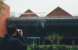 Man Taking Picture of Brown Green Building during Daytime Royalty Free Stock Images