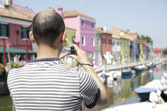 Man taking a picture of Burano Stock Photography