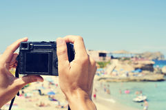 Man taking a picture at Cala Conta beach in San Antonio, Ibiza I Stock Photo