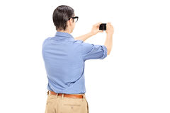Man taking a picture with cell phone Royalty Free Stock Image