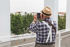 Man taking a picture at Expo 2015 in Milan, Italy Stock Photos