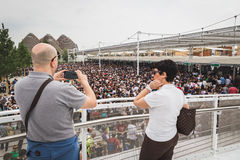Man taking a picture at Expo 2015 in Milan, Italy Royalty Free Stock Photography