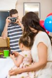 Man Taking Picture Of Family At Birthday Party Royalty Free Stock Photo