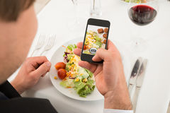 Man Taking Picture Of Food With Mobile Phone Royalty Free Stock Photography