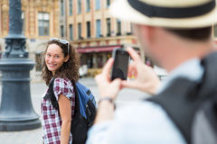 Man taking picture of his girlfriend on hoildays Royalty Free Stock Photos