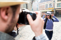 Man taking picture of his girlfriend on hoildays Stock Image