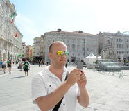 Man taking a picture with his smartphone Royalty Free Stock Images
