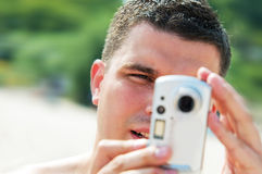 Man taking picture on holidays. On the beach Royalty Free Stock Photos