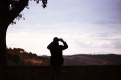 Man taking picture of landscape. Royalty Free Stock Photo