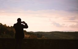 Man taking picture of landscape. Stock Images