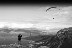 Man taking picture of Norway kite flyer background Stock Image