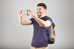 Man taking picture Stock Image
