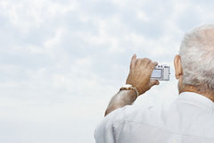 Man taking a picture of the sky Stock Photography