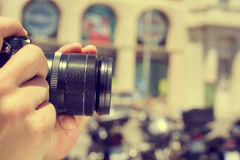 Man taking a picture in the street, with a filter effect royalty free stock photo