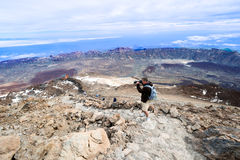 Man taking picture at top volcano Teide horizontal Stock Photos