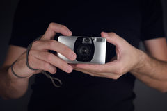 Man taking picture with vintage film camera. Man taking snapshot picture with vintage plastic generic film camera, amateur lomo photography hipster lifestyle Stock Image