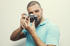 Man taking picture Stock Images