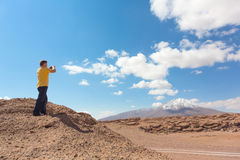 Man taking pictures on camera Royalty Free Stock Image