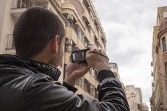 Man taking pictures of an emblematic building. Of the city of Alzira Valencia Spain Stock Image