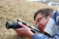 Man taking pictures in the field Royalty Free Stock Photos