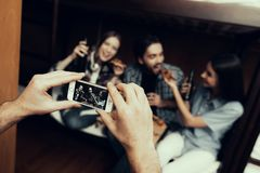 Man taking pictures of friends in Hostel royalty free stock images