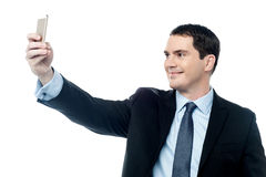 Man taking pictures of him self with smartphone Stock Photo