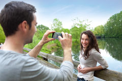 Man taking pictures of his girlfriend Royalty Free Stock Images