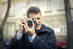 Man taking pictures Stock Photography