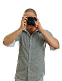 Man taking pictures with retro camera Stock Photo