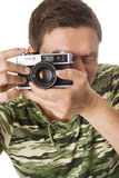 Man taking pictures with retro camera Stock Photography