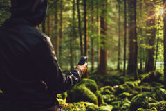 Man taking pictures in the woods Royalty Free Stock Photography