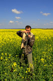 Man enjoying taking pictures yellow fields Royalty Free Stock Photography