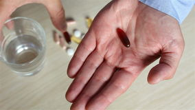 Man taking a pill. stock footage
