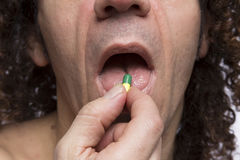 Man taking pill Stock Image