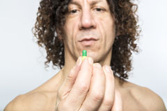 Man taking pill Royalty Free Stock Photography