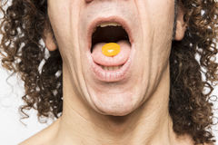 Man taking pill Royalty Free Stock Images