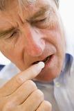 Man Taking Pills Stock Images