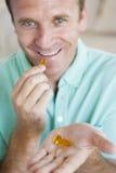 Man Taking Pills Stock Photos