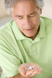 Man Taking Pills Stock Photography